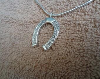 Silver horseshoe pendant, ( anti-tarnish .925 silver ) with chain.