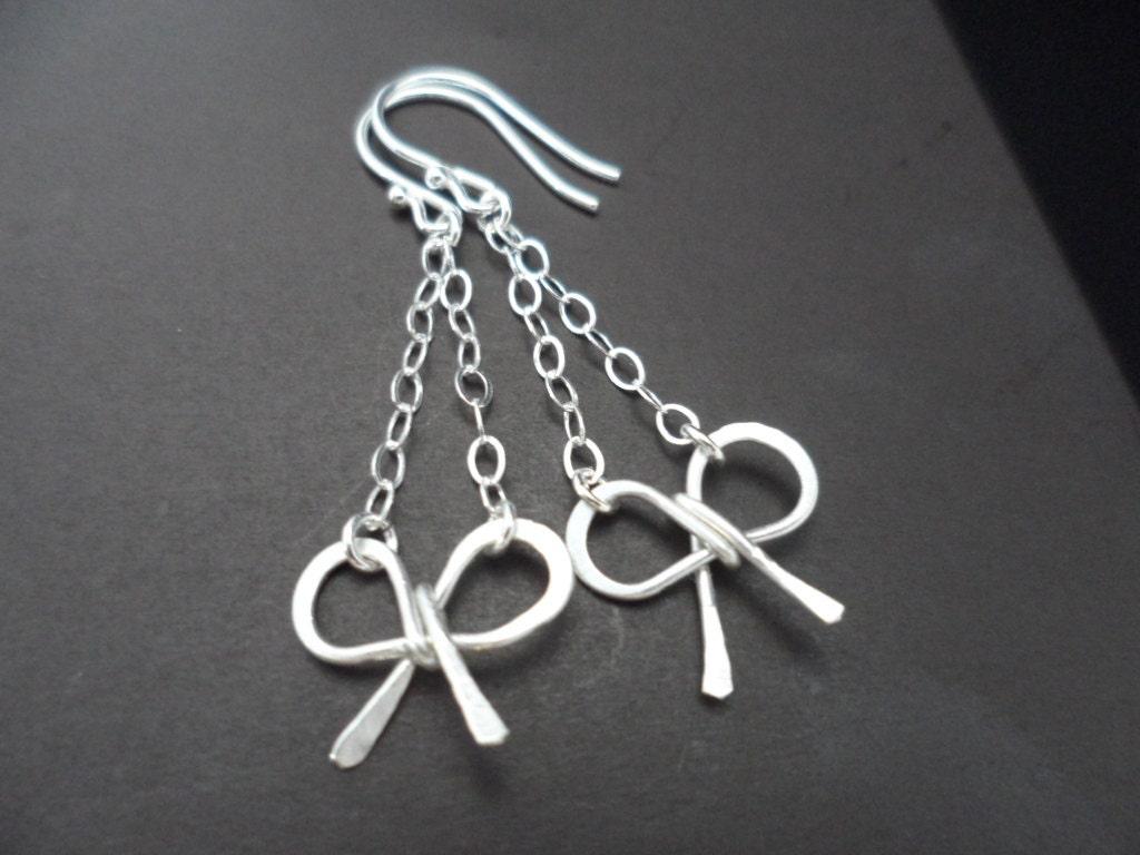 sale sterling silver bow dangle earrings by