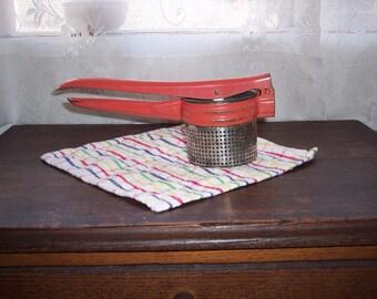 Vintage potato ricer red enamel potato masher retro kitchen gadget
