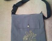 Shoulder bag from military uniform, jacket pocket with gold floral pat...