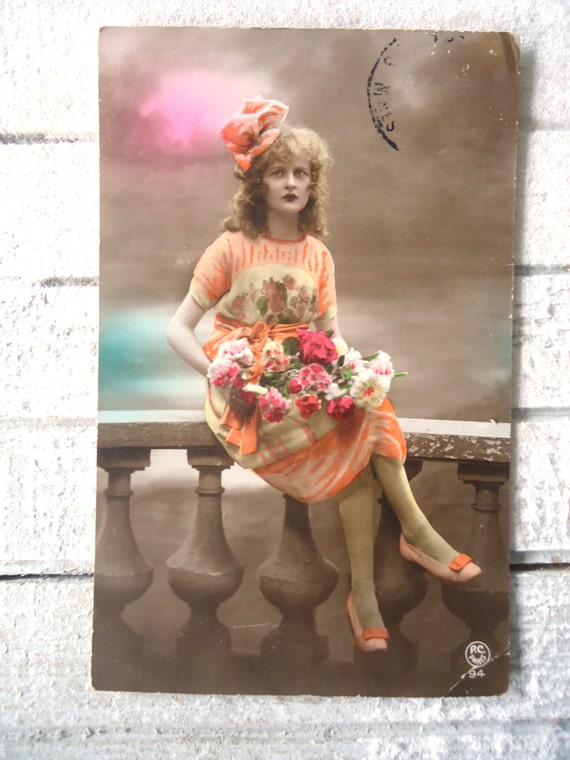 Antique french postcard - Woman, art deco dress, pattern, big ribbon, curly hair, balustrade, hand tinted, 1920