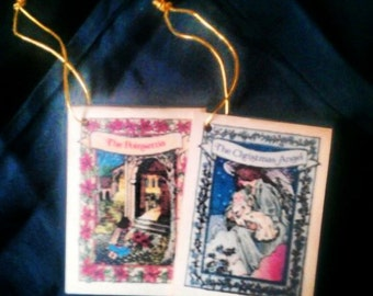 Sale Was 12.88 Now 8.00 Set of two Christmas Ornament books - The Christmas Angel & The Poinsettia By Nancy P McConnell