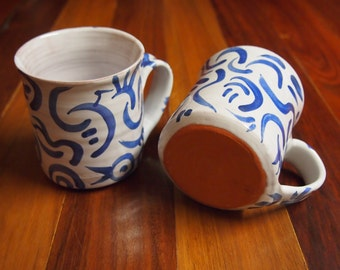 Handmade unique coffee mug- white majolica glaze with royal blue overglaze decoration