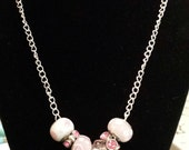 breast cancer charms on a silver plated chain