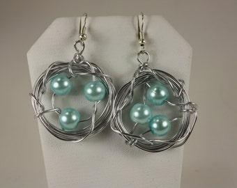 Silvertone nest wire w/ lt. blue pearls - fishhooks E 141