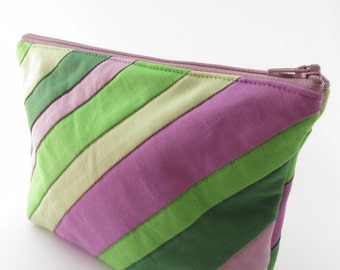Quilted, padded zippered pouch with diagonal green, mauve and purple stripes - Make up, cosmetic or gadget bag.
