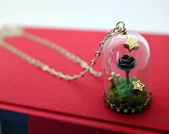 rose in a dome necklace. story domes, glass terrarium with moss and stars