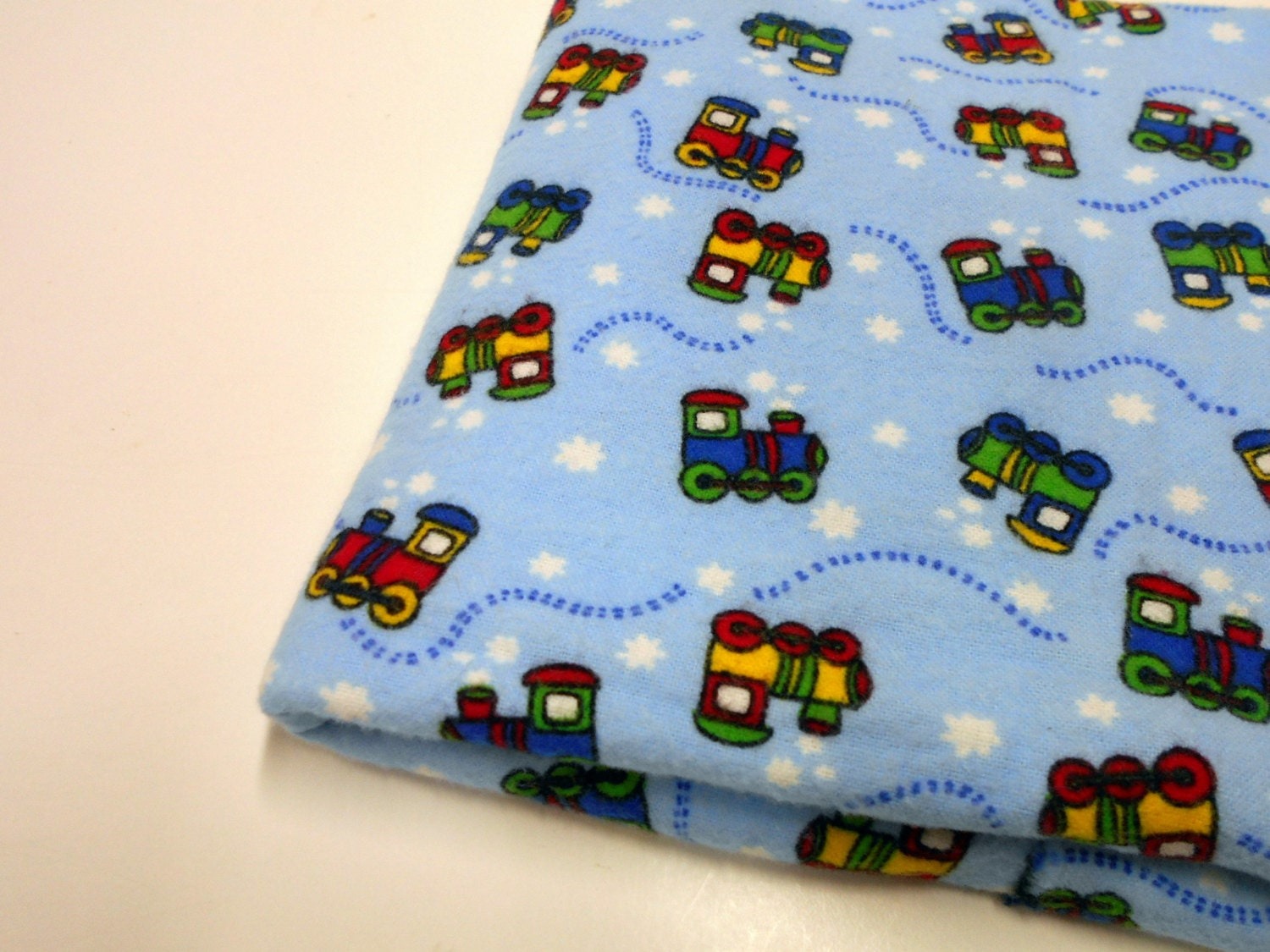 Little train engines flannel fabric blue train print by for Train print fabric