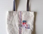 vintage grainsack tote bag - light oatmeal - book tote - red and blue stripes - blue handles - ticking - swiss cross applique - shoulder bag