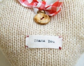 Large 'Thank you' knitted hanging heart decoration made from a lambswool blend yarn, with wooden button and ribbon tie details - Handmade.