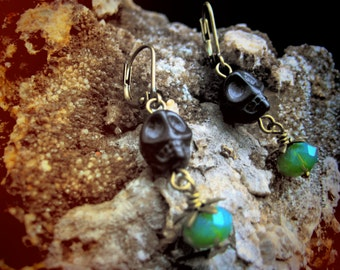 DEADLY NIGHTSHADE earrings carved obsidian skull and green glass with brass