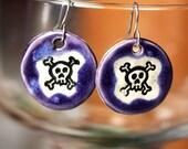 Skull and Crossbones Ceramic Earrings in Purple