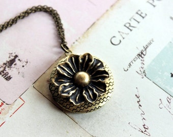 flower locket necklace. brass ox