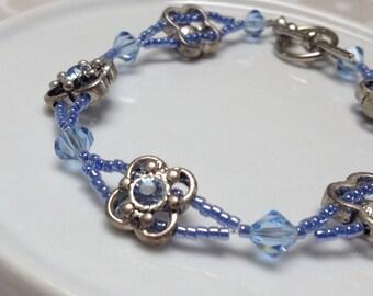 Light Sapphire Blue Swarovski Crystal and Flower Charm Bracelet