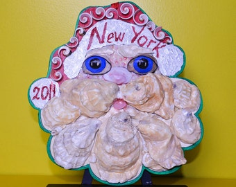 """Santa Claus seashell mosaic and acrilyc painting on the wood plate. Decoration collectible seashell wall nautical mask. 9"""" X 8.5""""""""."""