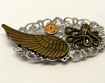 Steampunk jewelry. Steampunk octopus and angel wing brooch.