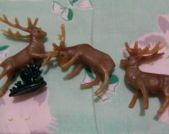 three itty bitty plastic deer