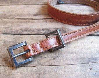 vintage c. 1980s Johnny Farah tan leather skinny belt with sterling silver buckle set, m