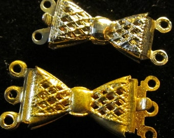 Gorgeous gold and silver colored Filigree  Bow Shaped  Clasps