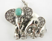 Antique Silver-tone Elephant Mom and Baby Elephant Pendant with Acrylic Turquoise Cabochon