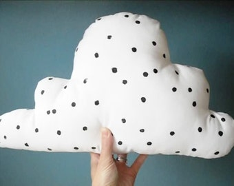 white stuffed cloud with black dots