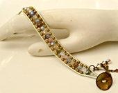 BOGO. Handmade beaded leather wrap bracelet. Bohemian, Baroque, beach, brass. Dragonfly and crystal charms. Single wrap, adjustable/