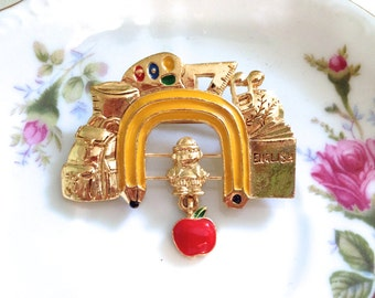 Vintage School Theme Brooch. Teacher. Gold with Colorful Enamel Accents. Apple. Pencil. School Books. Paint Palette. Kitsch. Whimsical Pin.