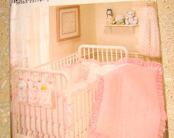Simplicity Nursery 9140 Nursery accessories include: Quilt, Bumpers, Dust Ruffle, Pillow, Diaper Stacker, Fitted Sheet,  Organizer. One Size