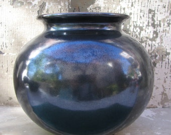 A Redware Pottery Pot in Opalescent Black