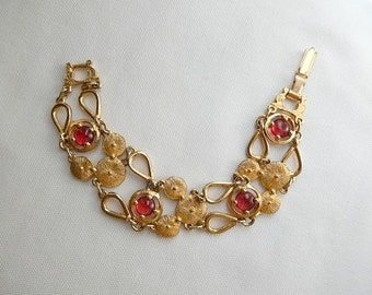 vintage bracelet, gold tone with red translucent cabochons, vintage jewelry