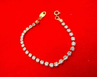 "Avon signed Vintage gold tone rhinestone  6."" bracelet in great condition, appears unworn"