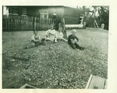 Kids Playing in a Pile of Rocks Gravel 1930s Boys Girls Sand Bucket Tin Cans Home Vintage Black and White Photo Photograph