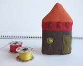 Tiny house brooch. Dark brown orange red with olive door and plant in pot