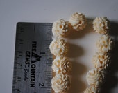 14 VINTAGE faux Ivory rose carved beads on thread