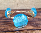 Light blue stones with gold wire bangle