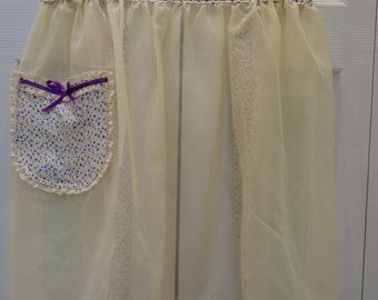 LADIES HALF APRON:Elegant, Hostess Apron, sheer and sexy, cream nylon, with a floral purple print, one pocket