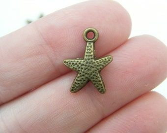 10 Starfish charms antique bronze tone BC100