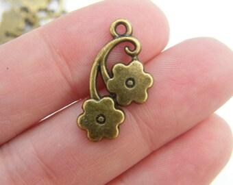 8 Flower pendants antique bronze tone BC107