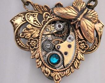 steampunk necklace, blue zircon necklace, ENCHANTED FOREST,  vintage Waltham 15 jeweled watch movement and Swarovski blue zircon glass jewel