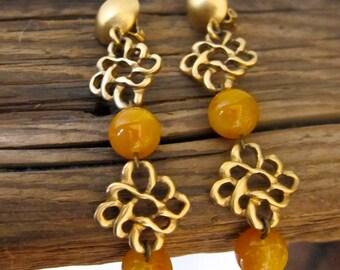 Vintage DKNY Clip Earrings Designer Donna Karan Amber Glass Matte Gold Tone Knots Celtic Look Signed