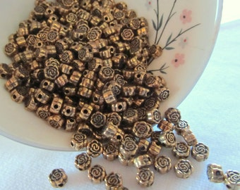 5mm textured bronze tone rose beads- 100 quantity