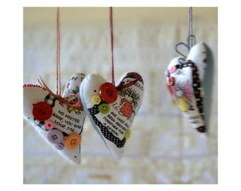 3 handmade hearts, with quotes, decorated with colorful buttons