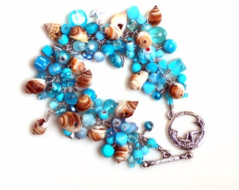 Beach bracelet by uniquenecks / cyan blue wire wrapped seashell handmade gift / brown nutmeg shells / mermaid clasp