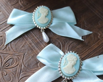 Beautiful cameo pin  with blue color bow   2 pieces listing