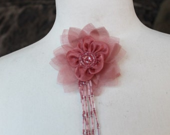 Cute   flower made from organza  with pin back and beads   1 piece listing
