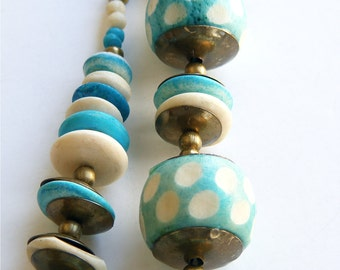 Vintage carved resin turquoise blue necklace 1960s. Polka dot and brass metal beads. Bohemian statement jewelry. Unworn dead stock.