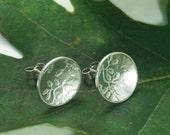 Silver Oak Leaf earrings: Sterling Silver discs with an oak leaf texture.