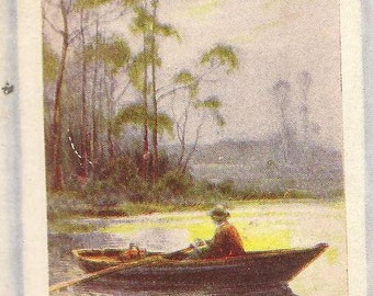 Single Rowboat on the Lake Under the Full Moon – serene and beautiful vintage postcard 1910 flag cancel