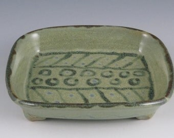 Small footed tray / dish in green with decoration