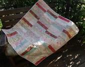 Floral strips lap quilt